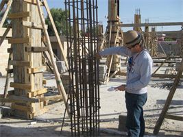 Adam Hamm, Civil/Structural Engineer with the U.S. Army Corps of Engineers Buffalo District, is conducting quality assurance by making sure the reinforcement for the concrete column has the correct spacing during the construction of the Al Dahkel elementary school in Dahuk, Iraq, Feb. 21, 2008.